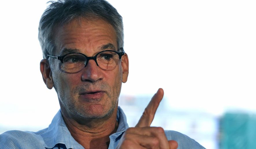"""Colorado-based author Jon Krakauer gestures during an interview with The Associated Press on Wednesday, Sept. 17, 2014, in Denver.  Three years ago, """"60 Minutes"""" and  Krakauer alleged that Greg Mortenson, author of """"Three Cups of Tea"""",  fabricated much of the book and mismanaged the charity he co-founded, Central Asia Institute. The Central Asia Institute lost most of its donors, with contributions plummeting from a high of about $22 million in 2010 to $2.7 million last year.  (AP Photo/Brennan Linsley)"""
