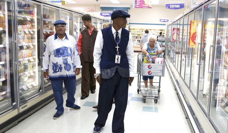 Michael Jackson tribute artist C.J. Williams shops for an upcoming party at a grocery store in Merrillville, Ind., on Sept. 10, 2014.  For fellow Gary native CJ Williams, being a Michael Jackson tribute artist is not about mimicking the spins and splits. It's about paying homage to the King of Pop.  Williams, who took third place at a recent talent contest in Gary coinciding with the anniversary of Jackson's birthday, has spent 12 years as an impersonator.  He has performed in Los Angeles, Philadelphia and Ohio and has plans to take his show farther.  (AP Photo/The Times, Jonathan Miano )  MANDATORY CREDIT; CHICAGO LOCALS OUT;  GARY OUT