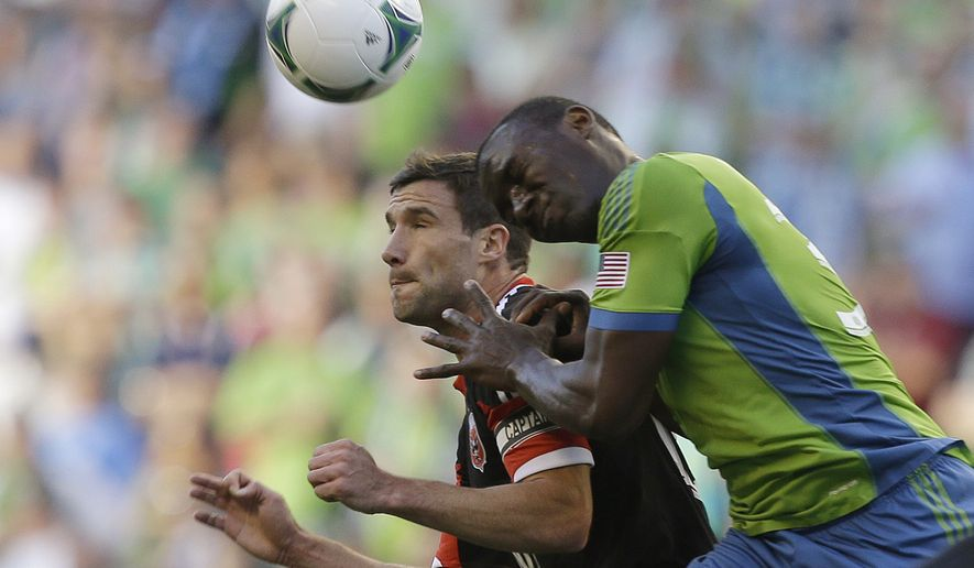 Seattle Sounders' Jhon Kennedy Hurtado, right, and D.C. United's Chris Pontius, left, vie for a header in the first half of an MLS soccer match, Wednesday, July 3, 2013, in Seattle. (AP Photo/Ted S. Warren)