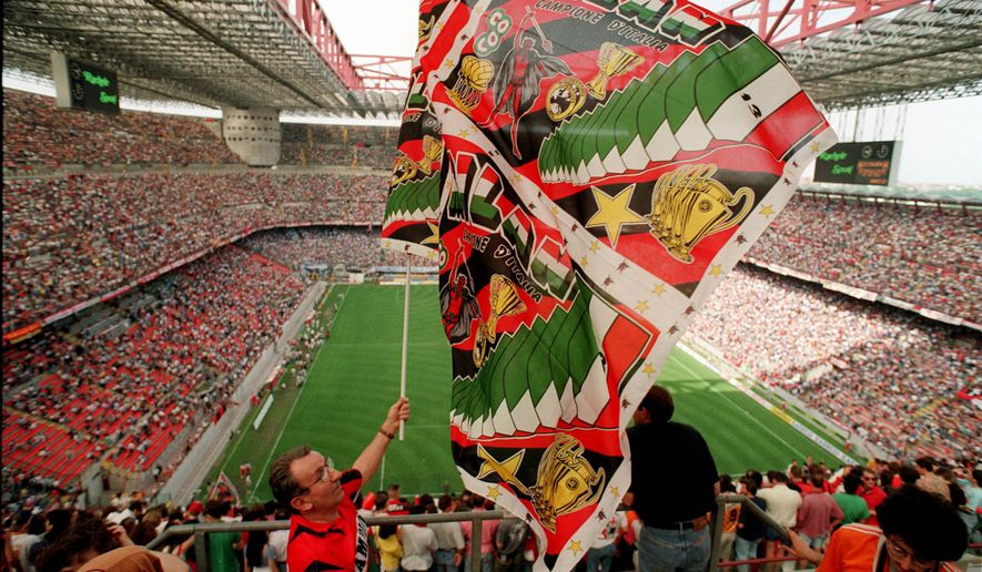A Milan fan waves the flag at the Milan's San Siro stadium in this file picture.  (AP Photo/Luca Bruno)