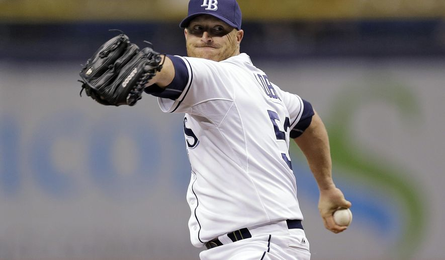 Tampa Bay Rays starting pitcher Alex Cobb goes into his windup against the New York Yankees during the first inning of a baseball game Wednesday, Sept. 17, 2014, in St. Petersburg, Fla. (AP Photo/Chris O'Meara)