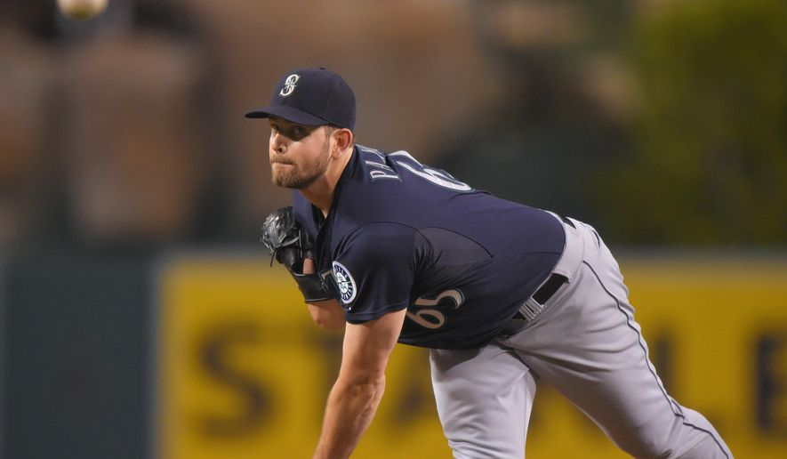 Seattle Mariners starting pitcher James Paxton throws to the plate during the first inning of a baseball game against the Los Angeles Angels, Wednesday Sept. 17, 2014, in Anaheim, Calif. (AP Photo/Mark J. Terrill)