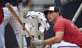 Washington Nationals' Ryan Zimmerman looks on during batting practice before a baseball game against the Atlanta Braves , Wednesday, Sept. 10, 2014, in Washington. (AP Photo/Nick Wass)