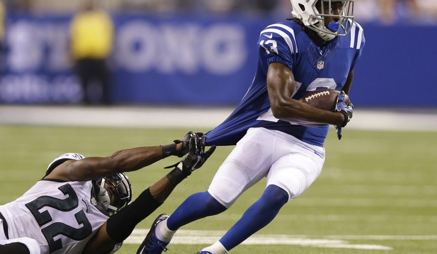Indianapolis Colts wide receiver T.Y. Hilton (13) runs out of the tackle of Philadelphia Eagles cornerback Brandon Boykin (22) during the second half of an NFL football game Monday, Sept. 15, 2014, in Indianapolis. (AP Photo/Michael Conroy)