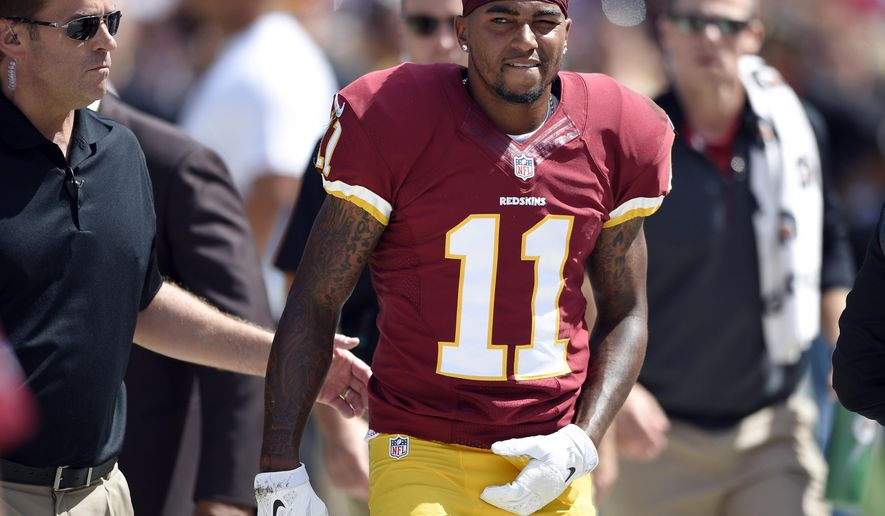 FILE - In this Sept. 14, 2014, file phot0, Washington Redskins wide receiver DeSean Jackson (11) walks off after being injured during the first half of an NFL football game against the Jacksonville Jaguars in Landover, Md. The Philadelphia Eagles never really gave a good reason for getting rid of Jackson. The Redskins don't care. If he can recover in time from a shoulder injury, he'll remind his old team of what they're missing when he returns on Sunday. (AP Photo/Nick Wass, File)