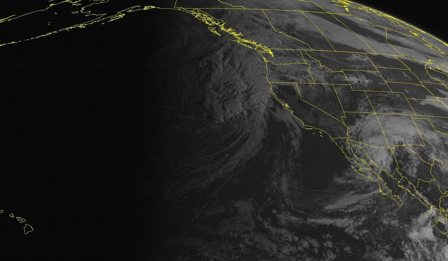 This NOAA satellite image taken Wednesday, September 17, 2014 at 11:00 AM EDT shows Tropical Depression moving northeast towards the Southwest US spreading clouds as far as western Texas and the southern Rockies with locally heavy rains for Arizona and New Mexico. Storm off the Pacific Northwest is spreading clouds to the Intermountain West and Northern Rockies with rain showers. (AP PHOTO/WEATHER UNDERGROUND)