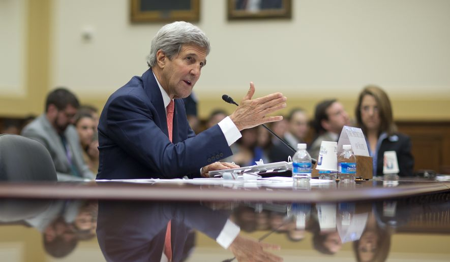 Secretary of State John Kerry testifies on Capitol Hill in Washington Thursday during a House Foreign Affairs Committee hearing. (AP Photo/Carolyn Kaster)