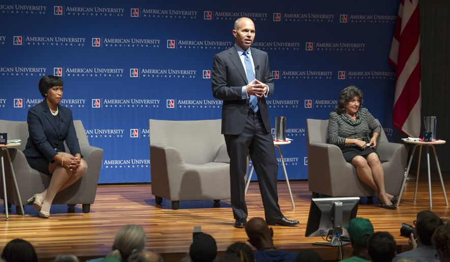 The three leading D.C. Mayoral candidates Councilmember Muriel Bowser, left, David Catania, Independent At-large District Councilman, center speaking, and Carol Schwartz, former Republican At-large District Councilwoman, meet face-to-face for their first debate at American University in Washington, Thursday, Sept. 18, 2014.  The election will take place on November 4, 2014, to elect the Mayor of Washington, D.C. (AP Photo/Cliff Owen)