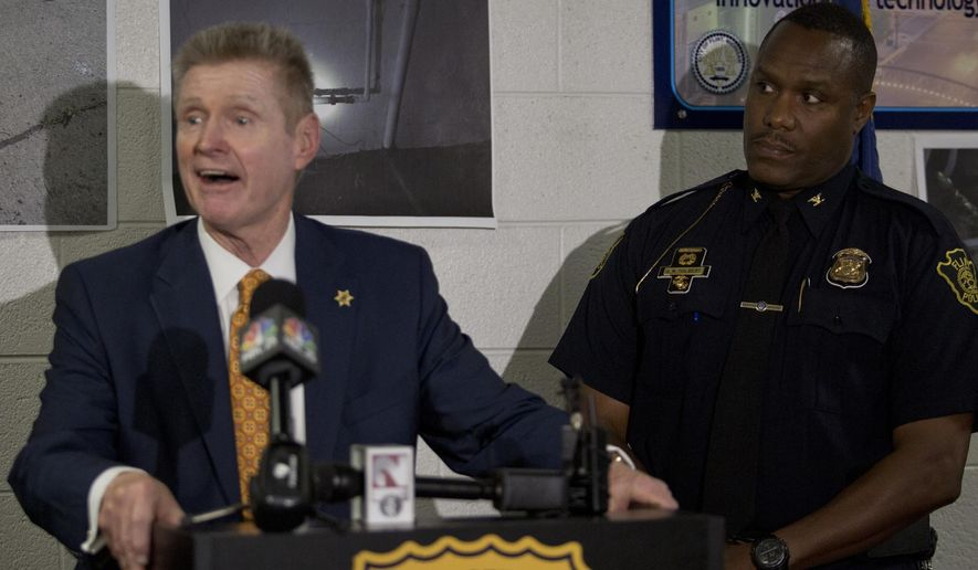 Flint Police Chief James W. Tolbert, right,  listens as Genesee Co. Sheriff Robert Pickell addresses the media during a news conference discussing the Flint water theft investigations on Wednesday, Sep. 17, 2014 in Flint at the Police Headquarters.  Flint authorities say they're investigating about 50 cases of water service theft and they're cracking down on those responsible. (AP Photo/The Flint Journal, Erin Kirkland) LOCAL TELEVISION OUT; LOCAL INTERNET OUT