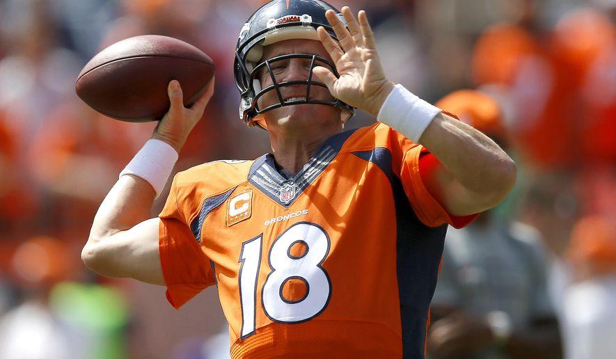 Denver Broncos quarterback Peyton Manning warms up prior to an NFL football game against the Kansas City Chiefs, Sunday, Sept. 14, 2014, in Denver. (AP Photo/Jack Dempsey)
