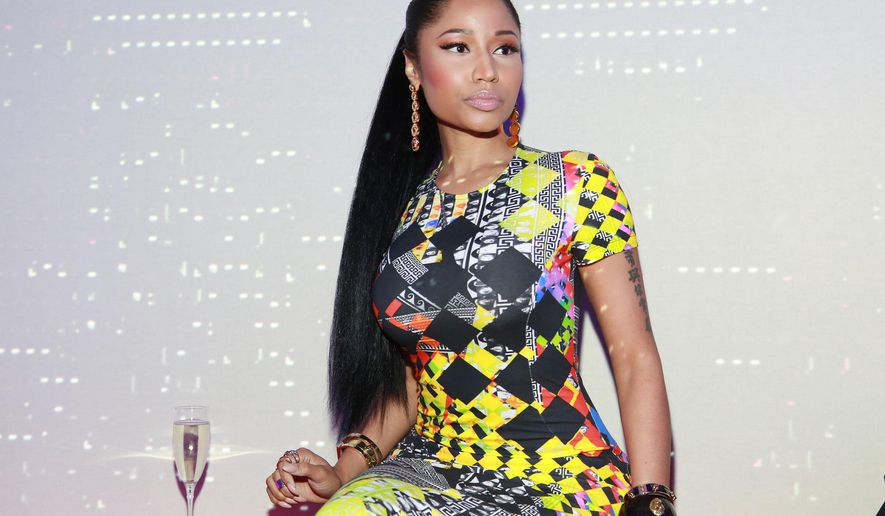 """FILE - In this Sunday, Sept. 7, 2014 file photo, Nicki Minaj seen at  X Versus Versace after party in New York. A federal judge in Atlanta has tossed out a lawsuit filed against rapper Minaj by her former wig designer. In a lawsuit in February, Terrence Davidson accused Onika Maraj, who uses the stage name """"Nicki Minaj,"""" and Pink Personality LLC of breaking implied contracts, reneging on discussions to launch a reality TV show and a wig line, and misappropriating his designs.  (Photo by Amy Sussman/Invision/AP, file)"""