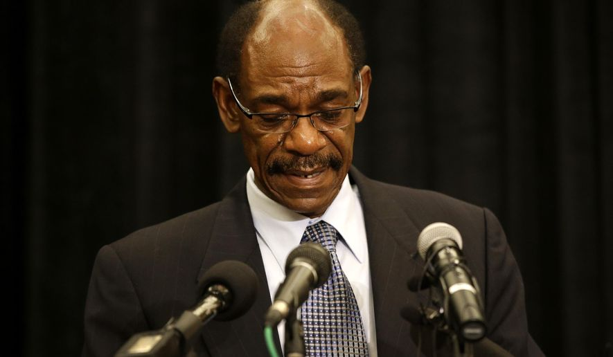 An emotional former Texas Rangers manager Ron Washington looks down at the podium as he makes a statement at a news conference, Thursday, Sept. 18, 2014, in Irving, Texas. (AP Photo/Tony Gutierrez)