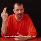 """An image from a video titled """"Lend Me Your Ears, Messages from the British Detainee John Cantlie,"""" which was posted on YouTube, is seen here."""