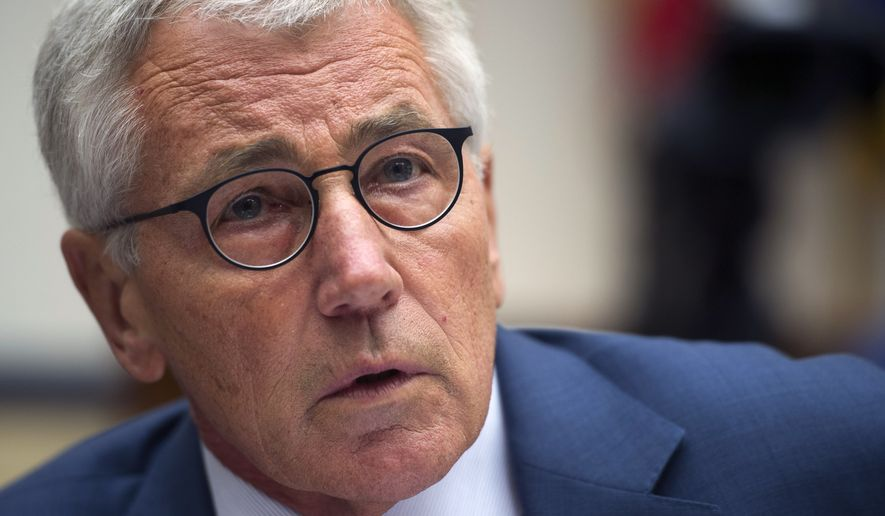 Secretary of Defense Chuck Hagel testifies before the House Armed Services Committee on Capitol Hill in Washington, Thursday, Sept. 18, 2014.   Hagel reiterated that if the Islamic State militants are left unchecked, they will threaten the United States and its allies.  (AP Photo/Cliff Owen)
