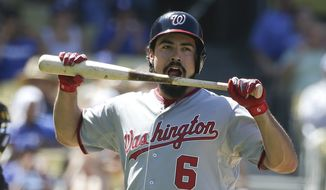 Washington Nationals' Anthony Rendon reacts after striking out during the eighth inning of a baseball game against the Los Angeles Dodgers Wednesday, Sept. 3, 2014, in Los Angeles. (AP Photo/Jae C. Hong)