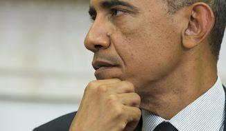 President Barack Obama listens to Ukrainian President Petro Poroshenko speak after a meeting in the Oval Office of the White House, on Thursday, Sept. 18, 2014, in Washington. (AP Photo/Evan Vucci)