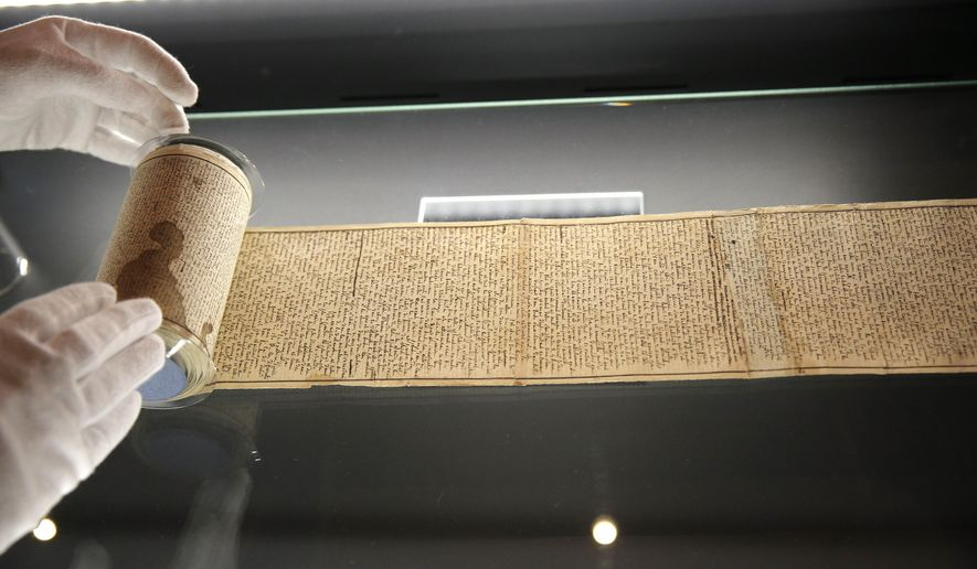 """The original scroll on which the Marquis de Sade wrote the draft of his novel 'The 120 Days of Sodom"""" is displayed at the Letters and Manuscripts Museum in Paris, Friday, Sept.19, 2014. The 12-metre (39 foot) long scroll was found in its hiding place when the Bastille prison was stormed during the 1789 French revolution and over the years has repeatedly changed hands. Returning to France, the parchment piece,  goes on display to mark the bicentenary of Sade's death. (AP Photo/Christophe Ena)"""