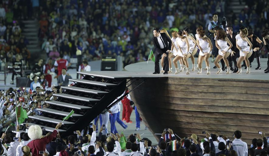 South Korean rapper PSY performs during the opening ceremony for the 17th Asian Games in Incheon, South Korea,Friday, Sept. 19, 2014. (AP Photo/Dita Alangkara)