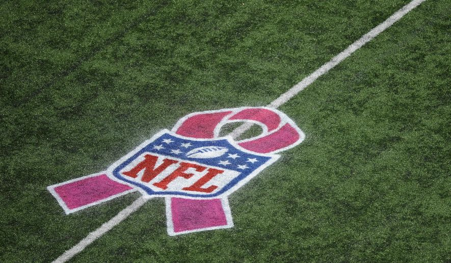 FILE - In this Oct. 14, 2012, file photo, an NFL pink ribbon logo commemorating Breast Cancer Awareness Month is painted on the field during an NFL football game between the Baltimore Ravens and the Dallas Cowboys in Baltimore. Procter & Gamble is canceling an on-field breast cancer awareness promotion it had been planning with the National Football League, the latest sponsor to respond to the NFL's growing problems.  (AP Photo/Nick Wass, File0