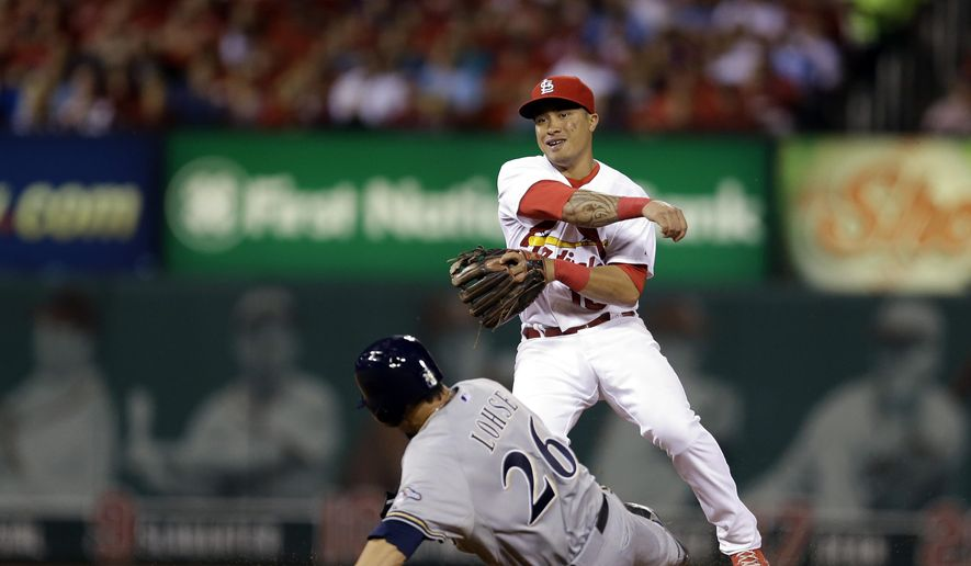 Milwaukee Brewers' Kyle Lohse, bottom, is out as second as St. Louis Cardinals second baseman Kolten Wong fails to turn the double play during the fifth inning of a baseball game Thursday, Sept. 18, 2014, in St. Louis. Brewers' Carlos Gomez was safe at first. (AP Photo/Jeff Roberson)