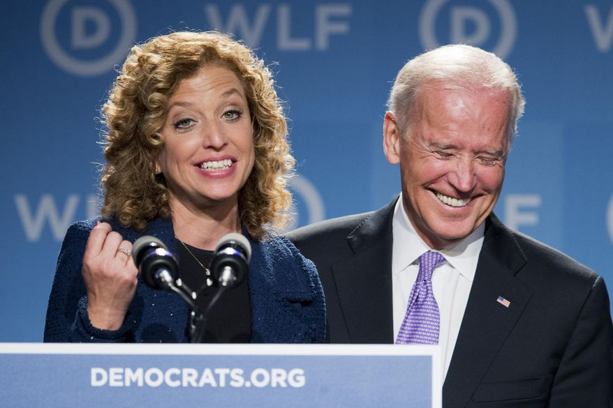 Vice President Joe Biden, right, laughs as he is introduced by DNC Chair Rep. Debbie Wasserman Schultz, D-Fla., at the DNC Women's Leadership conference in Washington, Friday, Sept. 19, 2014. (AP Photo/Manuel Balce Ceneta) ** FILE **