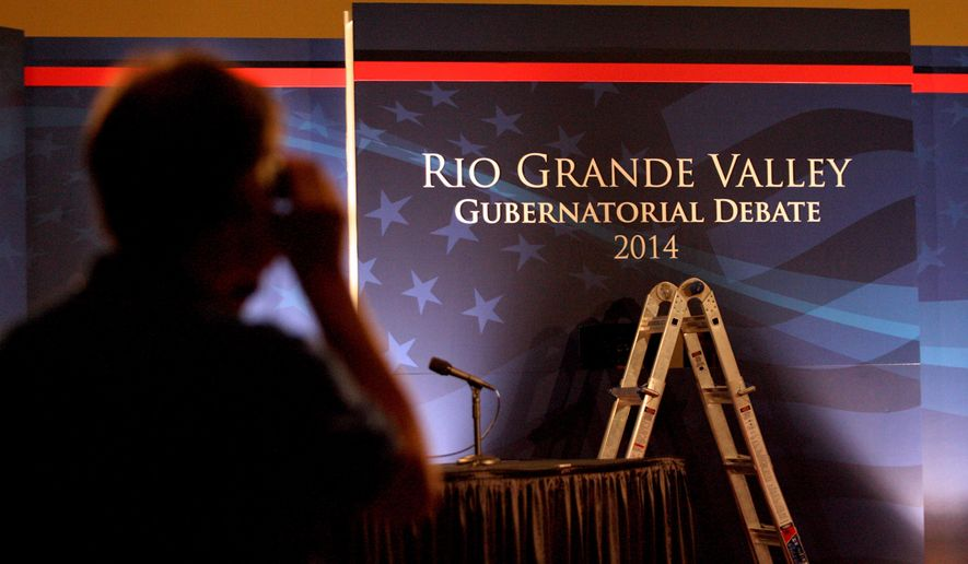 The stage is prepared for the 2014 Rio Grande Valley Gubernatorial Debate in Edinburg, Texas on Thursday, Sept. 18, 2104. The debate will feature Sen. Wendy Davis and Texas Attorney General Greg Abbott. (AP Photo/The McAllen Monitor, Delcia Lopez)