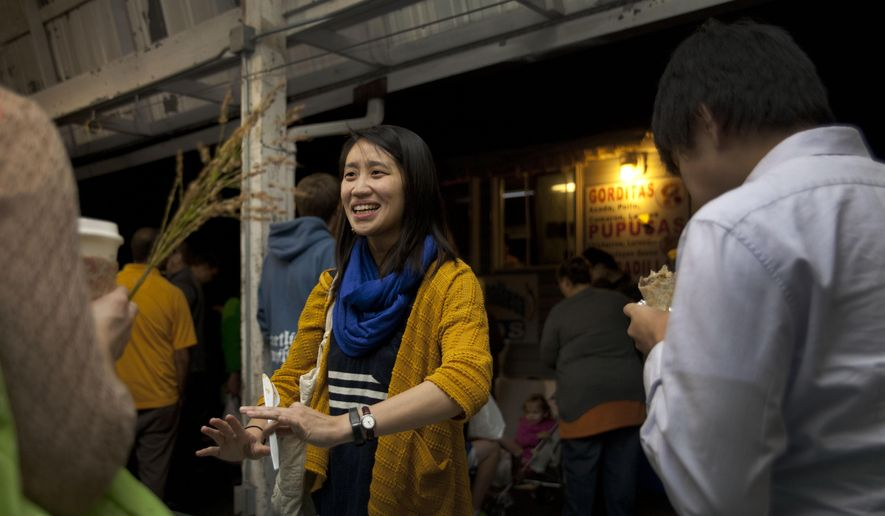 Rita Lin talks with friends at the food cart area during the Night Market at the Kalamazoo Farmers Market  Thursday  Sept. 18, 2014 in Kalamazoo, Mich. (AP Photo/Kalamazoo Gazette-MLive Media Group, Katie Alaimo) ALL LOCAL TELEVISION OUT; LOCAL TELEVISION INTERNET OUT