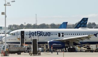 A JetBlue Airbus A320 airliner That has to return to long Beach, Calif., because of an emergency is seen at the Long Beach Airport in Long Beach, Calif., Thursday, Sept. 18, 2014. Federal Aviation Administration spokesman Ian Gregor said flight 1416 was bound for Austin, Texas, when the crew declared an emergency due to a problem with one of two engines on the Airbus A320. Airline spokesman Morgan Johnston said none of the 142 passengers and five crew members was injured during the evacuation, though three passengers were treated at the scene and one passenger was taken to a hospital for observation. (AP Photo/Damian Dovarganes)