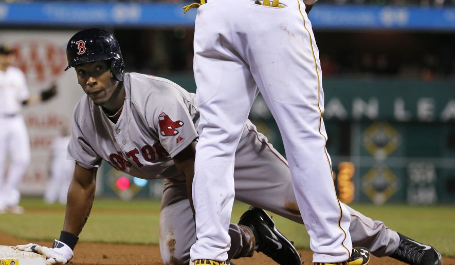 Boston Red Sox's Jemile Weeks gets up after being called out for being hit by a ground ball down the third baseline by Boston's Will Middlebrooks during the ninth inning of a baseball game against the Pittsburgh Pirates in Pittsburgh Thursday, Sept. 18, 2014. The Pirates won 3-2. (AP Photo/Gene J. Puskar)