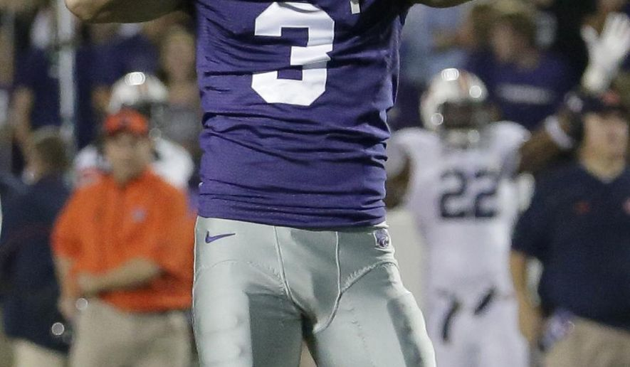 Kansas State place kicker Jack Cantele (3) reacts after missing his third field goal of the game during the second half of an NCAA college football game against Auburn Thursday, Sept. 18, 2014, in Manhattan, Kan. (AP Photo/Charlie Riedel)