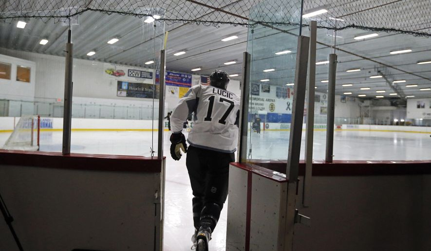 Boston Bruins left wing Milan Lucic (17) skates onto the ice during NHL hockey training camp in Wilmington, Mass., Friday, Sept. 19, 2014. (AP Photo/Elise Amendola)