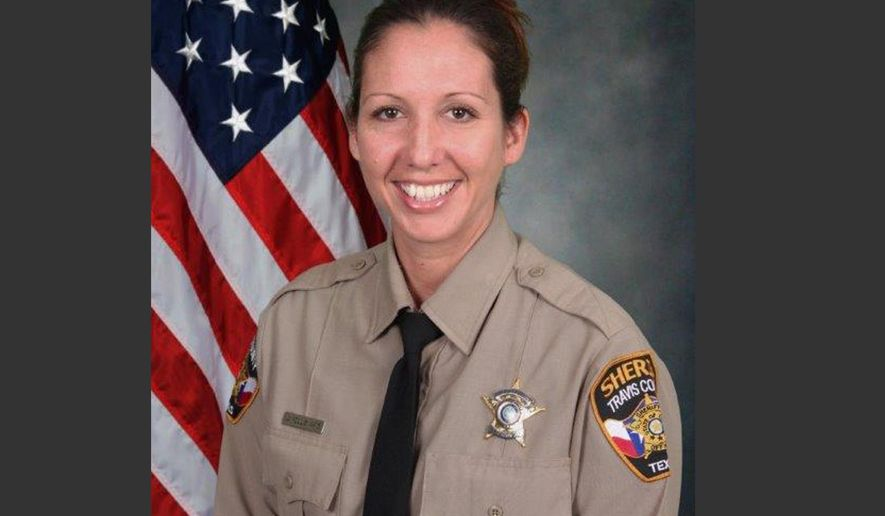 This undated photo provided by the Travis County Sheriff's Office on Friday, Sept. 19, 2014 shows Senior Deputy Jessica Hollis. On Friday, officials said her body was found after she was swept into Lake Austin when heavy rains flooded parts of Central Texas early Thursday. She was patrolling low water crossings looking for people in danger, according to a spokesman with the sheriff's office. (AP Photo/Travis County Sheriff's Office)