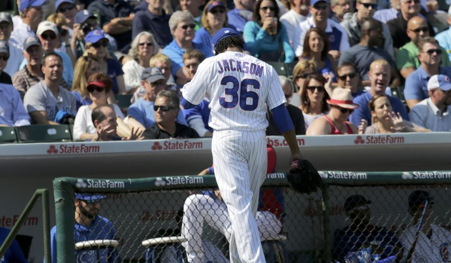 Chicago Cubs starting pitcher Edwin Jackson leave the game to a chorus of boos after only pitching two-thirds of the first inning of a baseball game against the Los Angeles Dodgers Friday, Sept. 19, 2014, in Chicago. (AP Photo/Charles Rex Arbogast)
