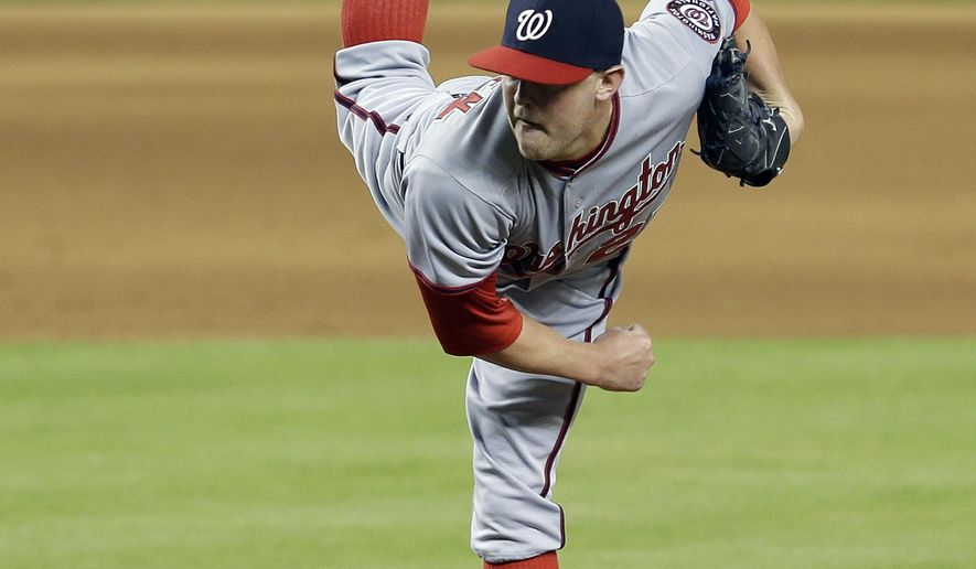 Washington Nationals relief pitcher Drew Storen throws against the Miami Marlins in the ninth inning of a baseball game in Miami, Friday, Sept. 19, 2014. The Nationals won 3-2. (AP Photo/Alan Diaz)