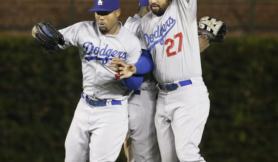 Los Angeles Dodgers outfielders Carl Crawford (3), left, Yasiel Puig (66) and Matt Kemp (27) celebrate after the Dodgers defeated the Chicago Cubs 8-4 in a baseball game in Chicago, Thursday, Sept. 18, 2014. (AP Photo/Nam Y. Huh)
