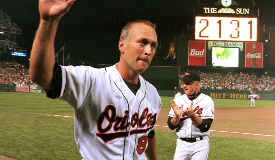 FILE - In this Sept. 6, 1995, file photo, Baltimore Orioles' Cal Ripken Jr. waves to the crowd as the sign in centerfield reads 2,131, signifying Ripken had broken Lou Gehrig's record of playing in 2,130 consecutive games, at Camden Yards in Baltimore.  (AP Photo/Denis Paquin, File)