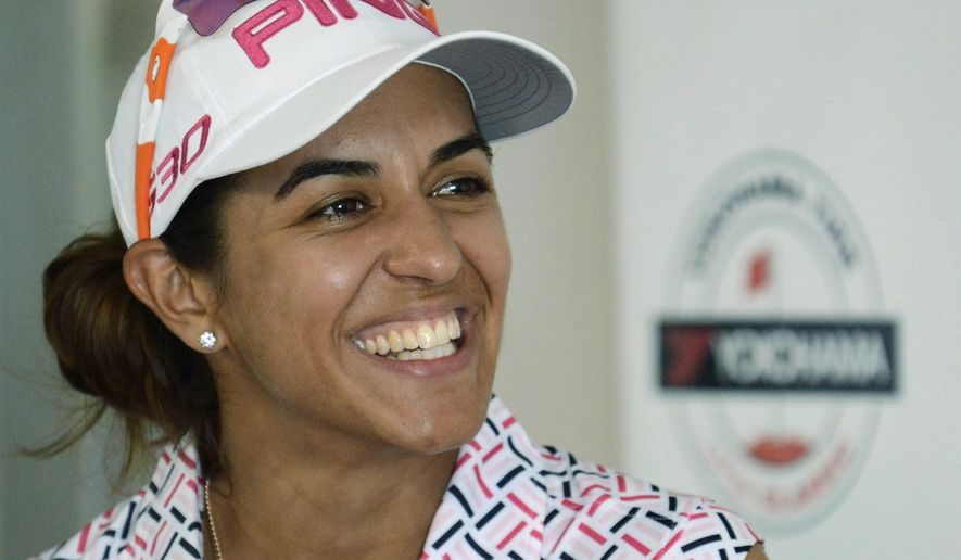 Paula Reto is all smiles at a news confernece after finishing with two-day score of13 under par after the second round of the LPGA Classic golf tourament at the Robert Trent Jones Golf Trail at Capitol Hill in Prattville, Ala., Friday, Sept. 19, 2014. (AP Photo/ Montgomery Advertiser, Mickey Welsh) NO SALES