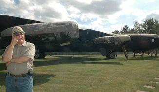 In a photo from Sept. 9, 2014, Bob Vick, president and chief executive officer of the K.I. Sawyer Heritage Air Museum, stands by the B-52-D Stratofortress, one of the planes on display in the static exhibit area of the museum in Marquette, Mich. The Cold War is over, but the memories linger and they're memories that should be kept alive. That's one reason for the creation of the museum in the former Silver Wings Recreation Center at the former U.S. Air Force base. The museum was founded by members of local Air Force Association Lake Superior Chapter 238 in 1993 when it was learned Sawyer Air Force Base was going to be shut down. (AP Photo/The Mining Journal, Christie Bleck)