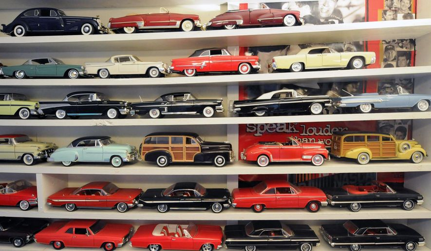 This photo taken Aug. 21, 2014, shows Roger Pridgen's model car and truck collection at his home in Wilmington, NC. Pridgen, a retired electrician, converted a spare bedroom into a sort of automotive museum with floor-to-ceiling shelves stuffed with Chevys, Fords, Cadillacs and other models of classic cars, depicting makes and models dating from the late 1930's to the present.  (AP Photo/The Star-News, Matt Born)