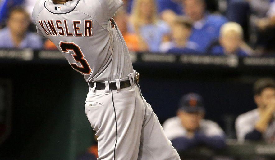 Detroit Tigers' Ian Kinsler follows through on a two-run home run during the fifth inning of a baseball game against the Kansas City Royals on Friday, Sept. 19, 2014, in Kansas City, Mo. (AP Photo/Charlie Riedel)