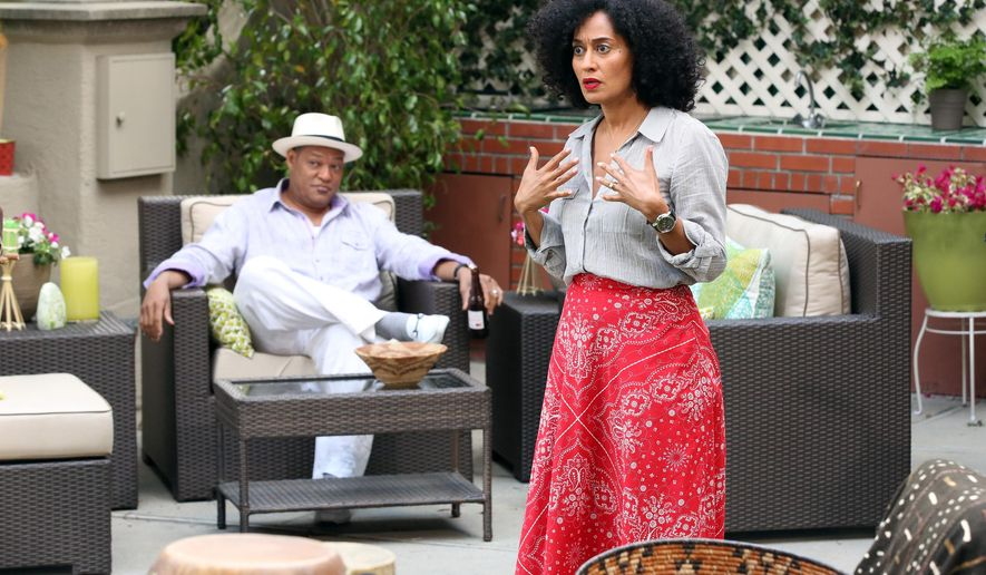 """This image released by ABC shows aurence Fishburne, left, and Tracee Ellis Ross in a scene from the comedy """"Black-ish,"""" premiering Sept. 24. (AP Photo/ABC, Adam Taylor)"""