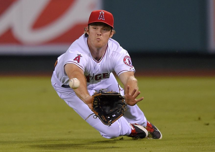 Los Angeles Angels right fielder Brennan Boesch makes a diving catch on a ball hit by Seattle Mariners' Robinson Cano during the fourth inning of a baseball game, Thursday Sept. 18, 2014, in Anaheim, Calif. (AP Photo/Mark J. Terrill)