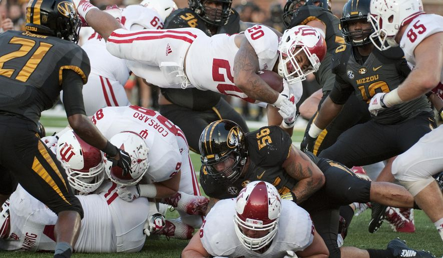 Indiana running back D'Angelo Roberts, center, leaps over several players as he scores the game-winning touchdown late during the fourth quarter of an NCAA college football game Saturday, Sept. 20, 2014, in Columbia, Mo. Indiana upset Missouri 31-27. (AP Photo/L.G. Patterson)