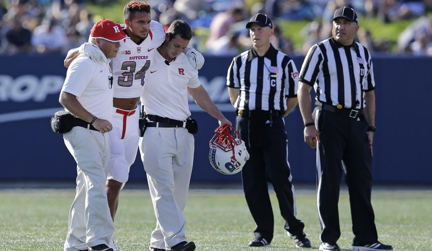 Rutgers running back Paul James (34) is assisted off the field after a play in the first half of an NCAA college football game against Navy in Annapolis, Md., Saturday, Sept. 20, 2014. He did not return to the game. (AP Photo/Patrick Semansky)