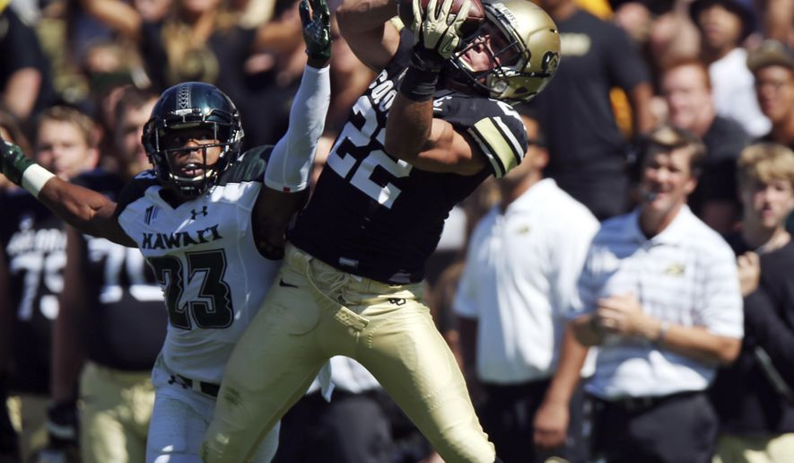 Colorado wide receiver Nelson Spruce, right, pulls in pass for touchdown as Hawaii defensive back Dee Maggitt covers during the first quarter of an NCAA college football game in Boulder, Colo., Saturday, Sept. 20, 2014. (AP Photo/David Zalubowski)