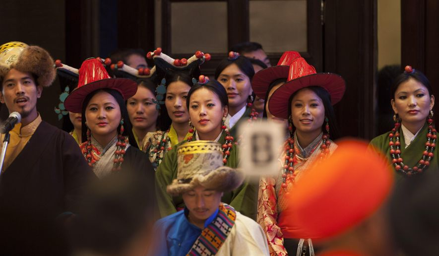 Exile Tibetans perform a religious song during an inter-faith meeting in New Delhi, India, Saturday, Sept. 20, 2014. The Dalai Lama brought religious leaders together Saturday to mull some of India's most pressing problems, from gender violence to widespread poverty, while praising the country's religious harmony as proof to the world that different communities can live peacefully together. (AP Photo/Tsering Topgyal)