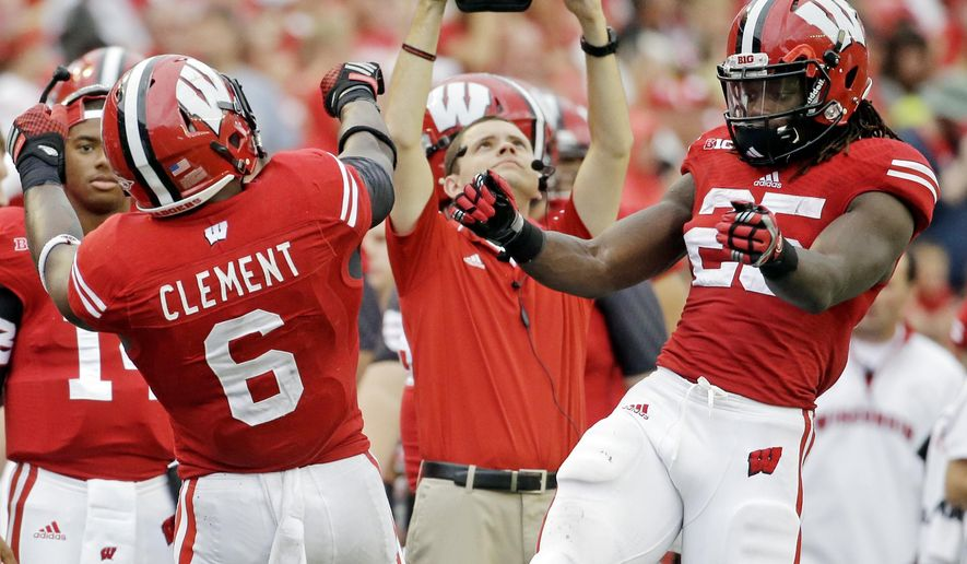 Wisconsin's Corey Clement (6) celebrates his touchdown run with teammate Melvin Gordon during the second half of an NCAA college football game against Bowling Green, Saturday, Sept. 20, 2014, in Madison, Wis. (AP Photo/Morry Gash)