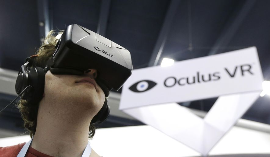 In this March 19, 2014 file photo, Peter Mason tries the Oculus virtual reality headset at the Game Developers Conference 2014 in San Francisco.  (AP Photo/Jeff Chiu, file)