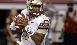 """FILE - In this Aug. 30, 2014, file photo, Florida State quarterback Jameis Winston rolls out of the pocket in the first half of an NCAA college football game against Oklahoma State in Arlington, Texas. Florida State has suspended Winston for the entire game against Clemson on Saturday, Sept 20, extending its initial punishment of one half after the quarterback made """"offensive and vulgar"""" comments about female anatomy earlier this week. (AP Photo/Tony Gutierrez, File)"""