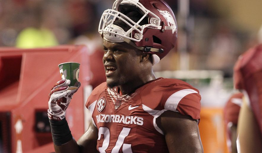 Arkansas linebacker Braylon Mitchell watches the fourth quarter an NCAA college football game in Fayetteville, Ark., Saturday, Sept. 20, 2014. Arkansas defeated Northern Illinois 52-14. (AP Photo/Danny Johnston)